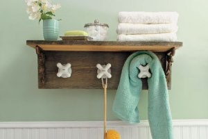 Cute bathroom shelf with tap heads for hooks