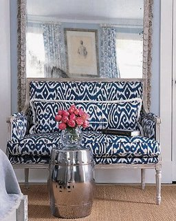 Bold fabric with an oversized mirror works well to calm the space and create a focal point.