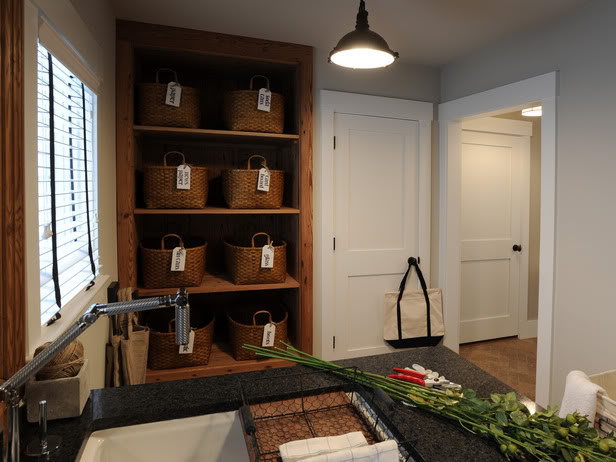 Decoration for inspiration: The shelving unit and baskets are pretty and add usefull storage space in this scullery.