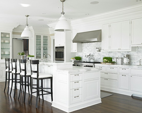 multi level island with raised part for bar like seating  this also aids solutions to oversized kitchen islands   salome interiors  rh   salomeinteriors com